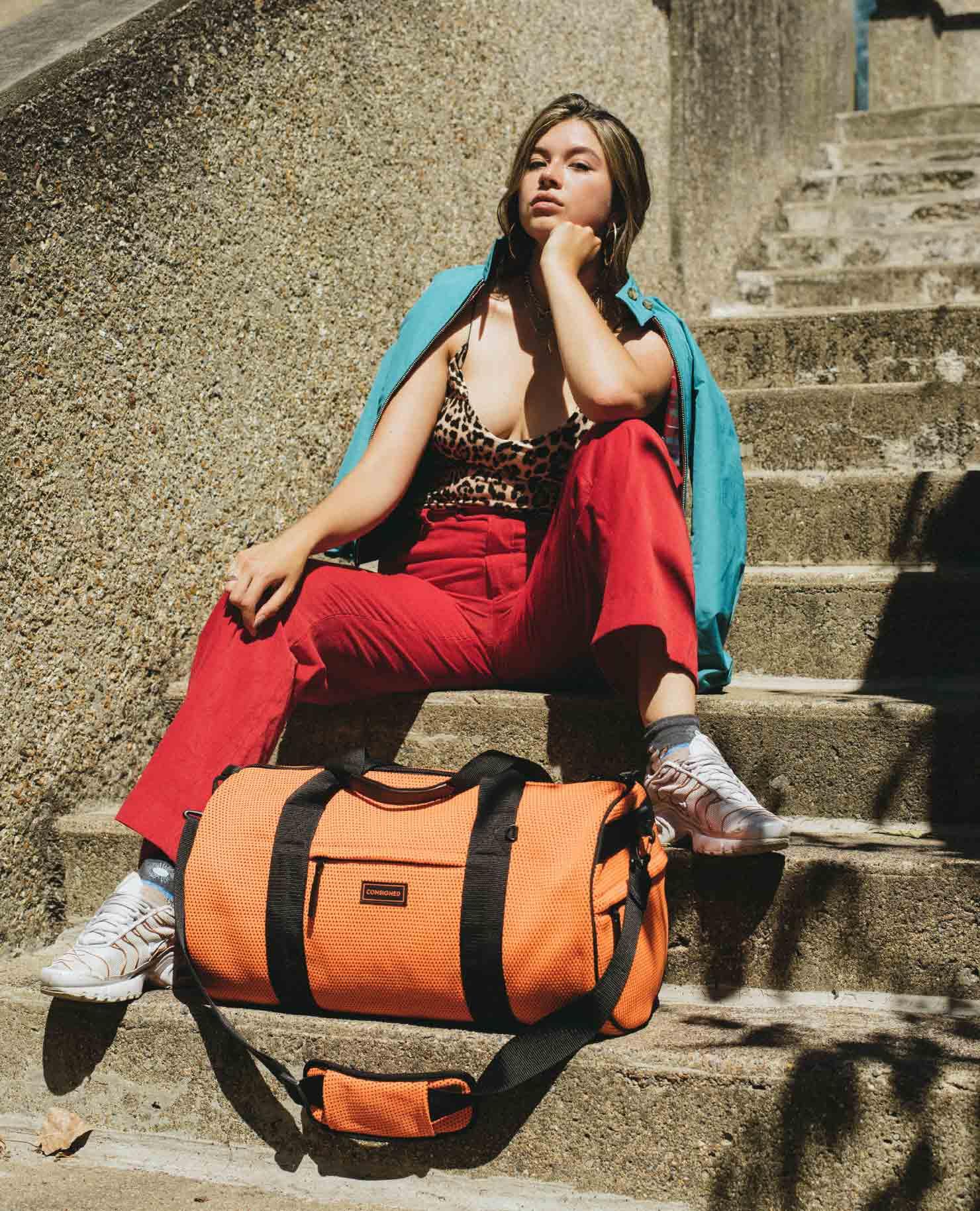 Ceara Maya Modeling The Saint Marlin Holdall In Orange On Stairs