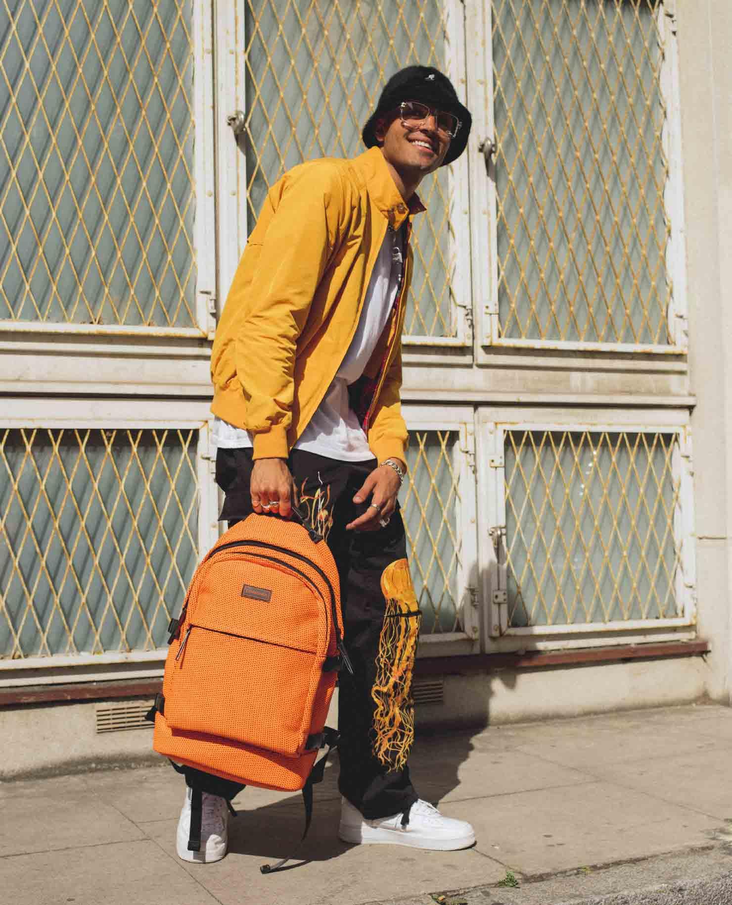 Elias Riadi Modeling The Saint Barton Backpack In Orange